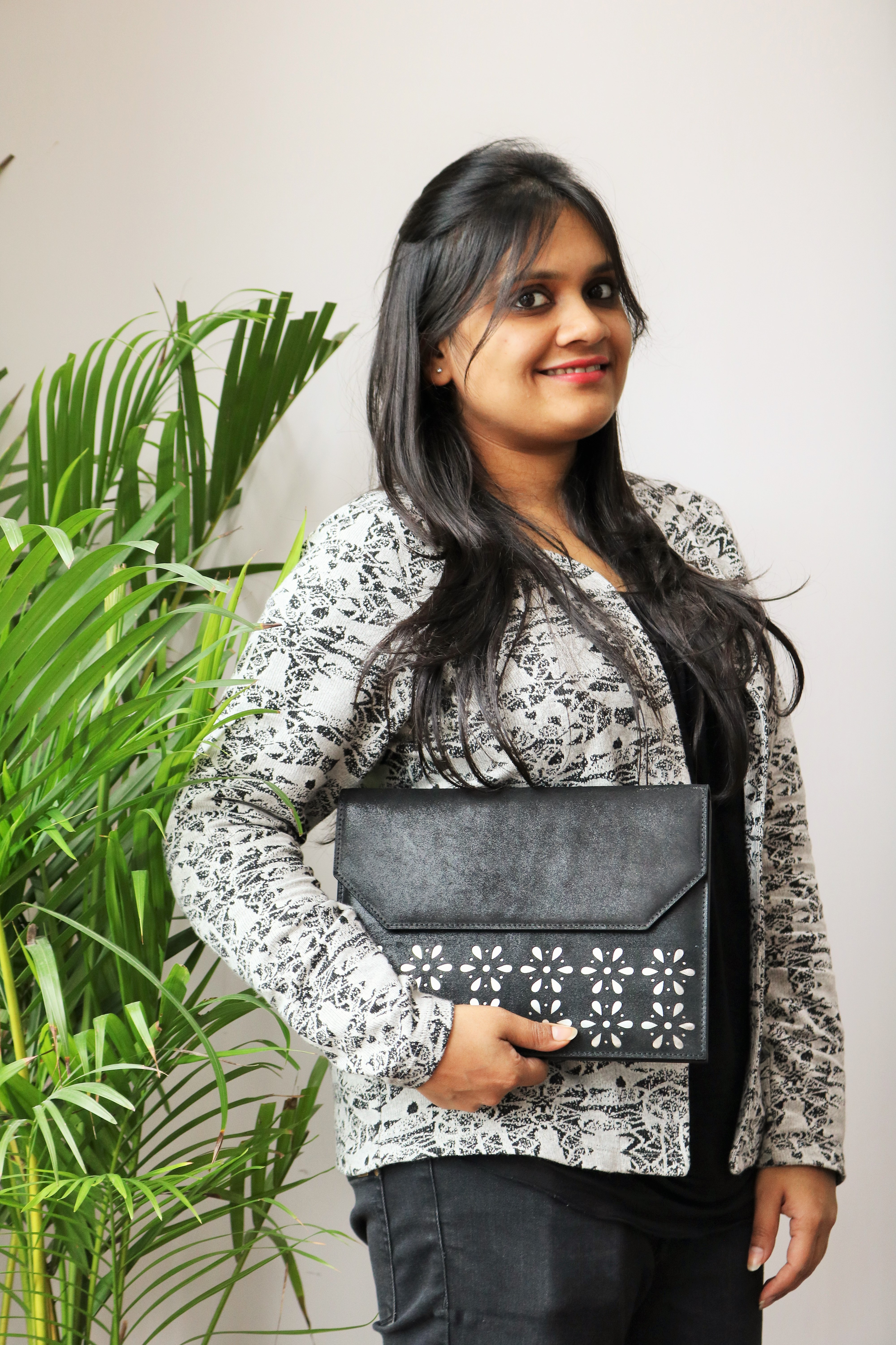 Ayushi with one of her bags